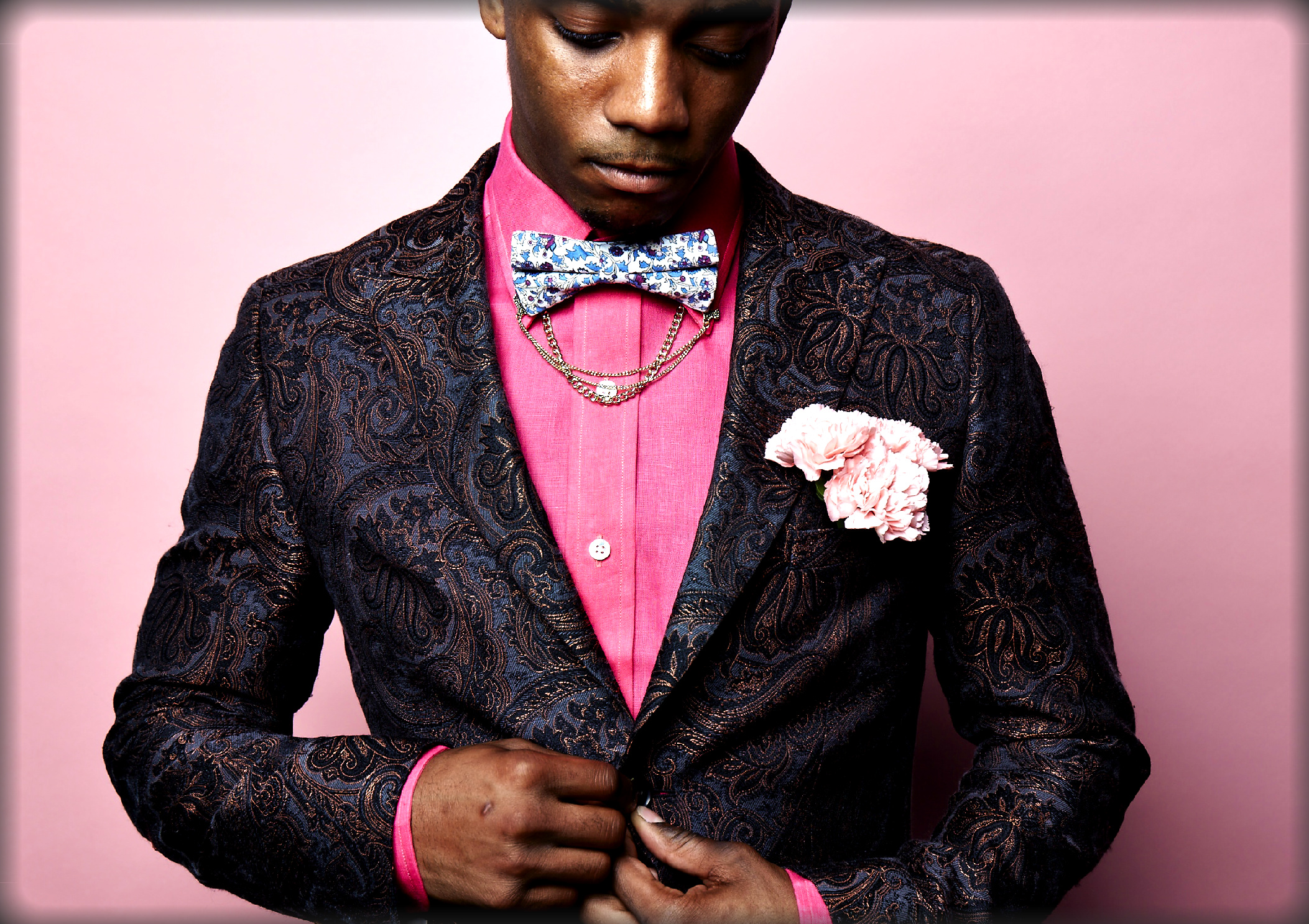 Fashion model with a pink shirt and creative bow tie